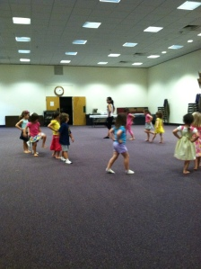 Students at BMH-BJ demonstrate how they march in a circle during 'The Wheels on the Bus!' activity.