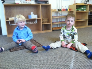 Boys at the Montessori Children's House of Denver pack up their lunches during warm ups in dance class.